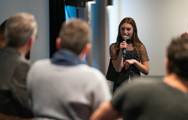 image of Third-place winner Kara Puerschner delivers her pitch at the 2018 Seattle Film Summit Pitch Panel event.