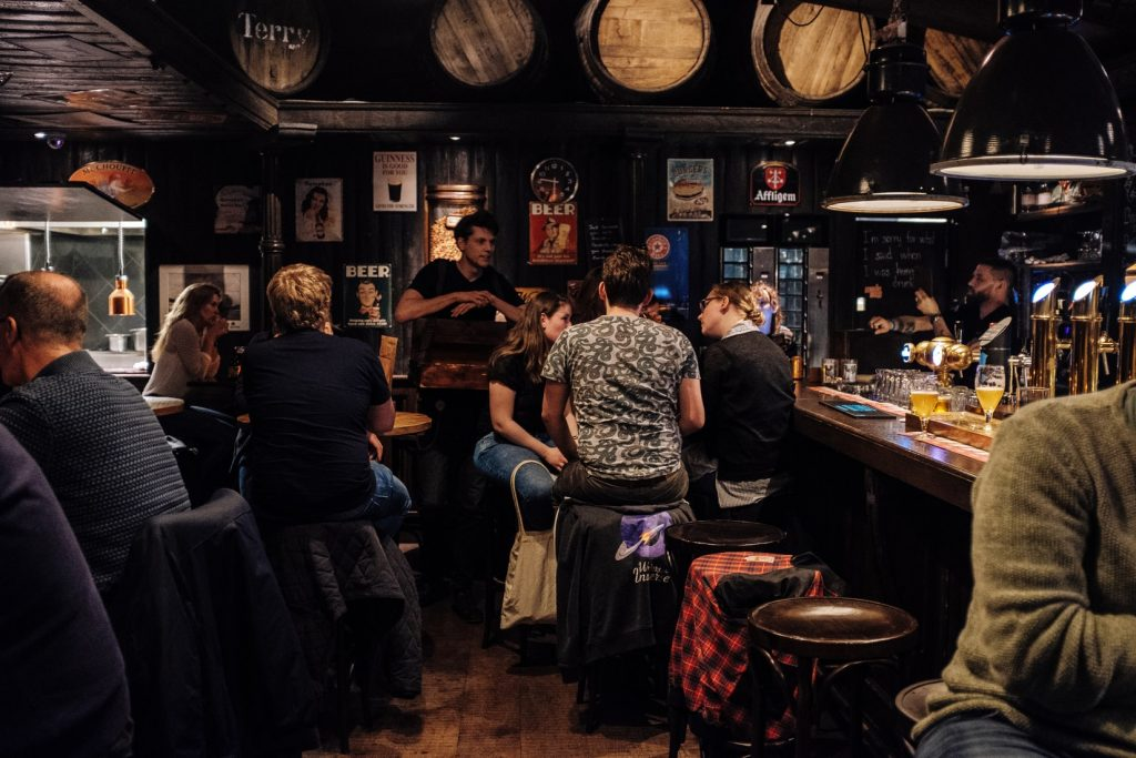 image of people gathered at a bar